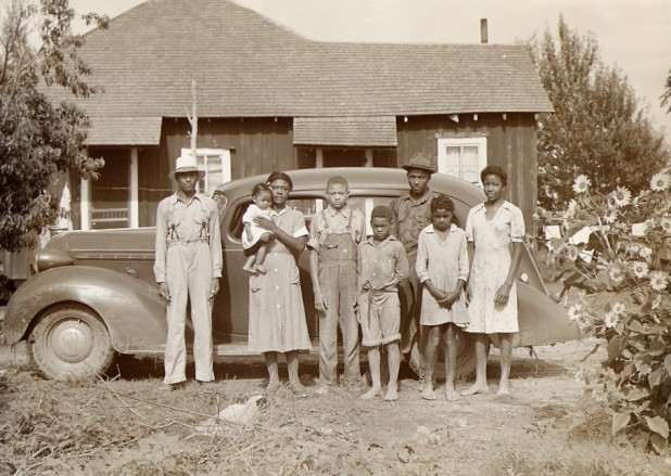 african-american-family-posing-front-of-home.jpg